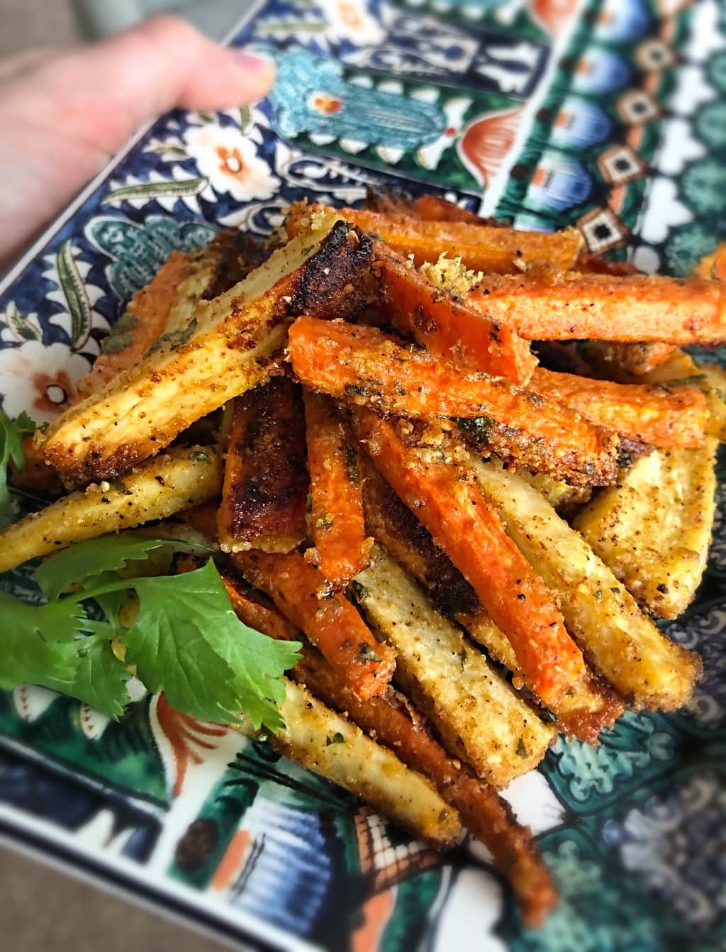 harissa root vegetables fries on a blue and orange tray