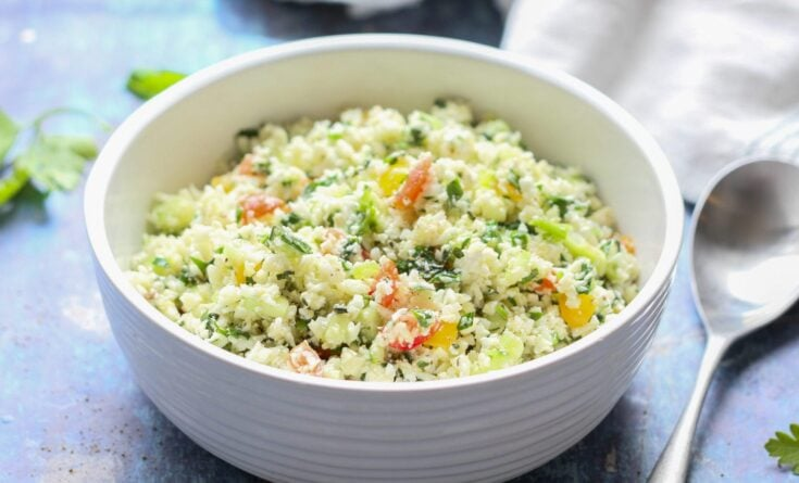 keto low carb cauliflower tabbouleh salad in a white bowl