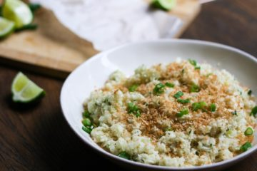 toasted coconut ginger cauliflower rice in a white bowl