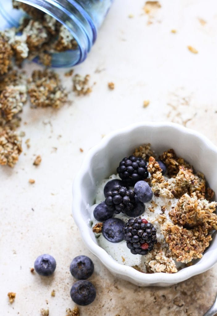 granola and berries in white dish