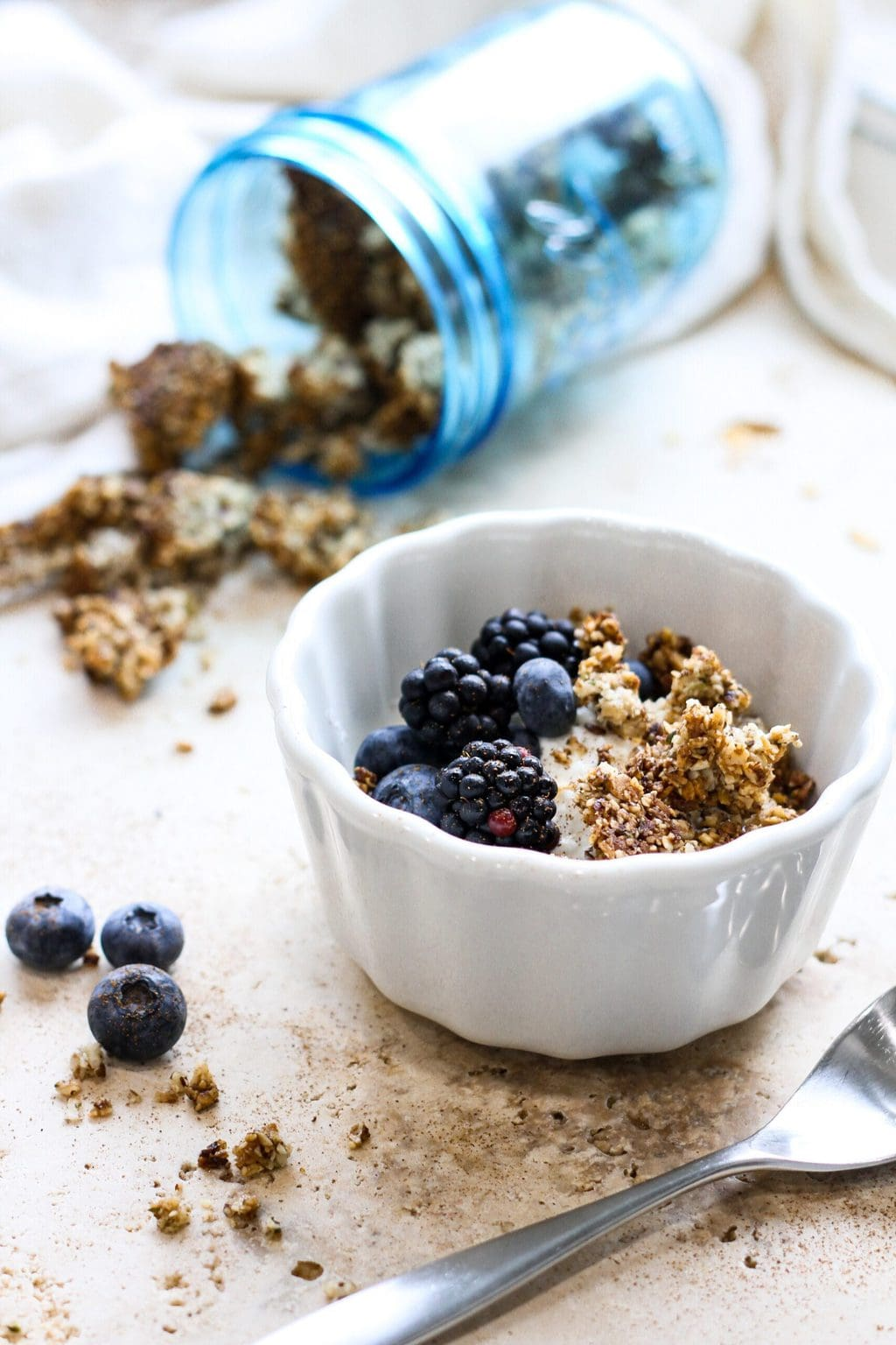 bowl of coconut yogurt with granola and berries