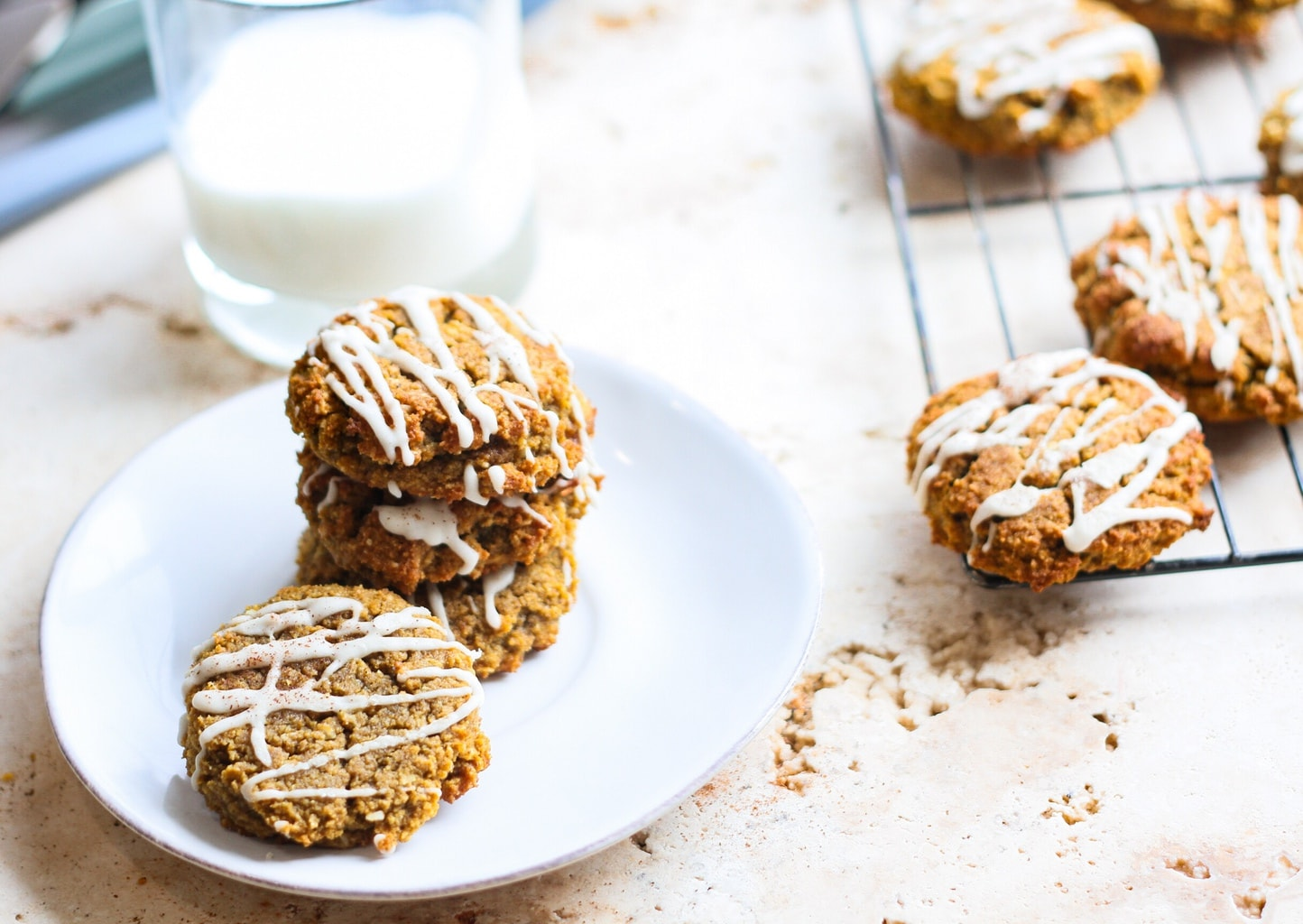 iced pumpkin cookies with a glass of milk