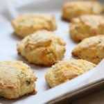 a baking tray with cheddar chive biscuits