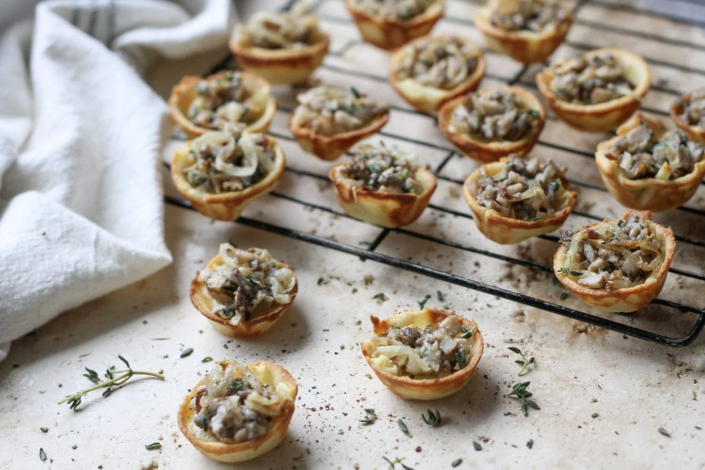 caramelized onion mushroom brie bites on a wire rack