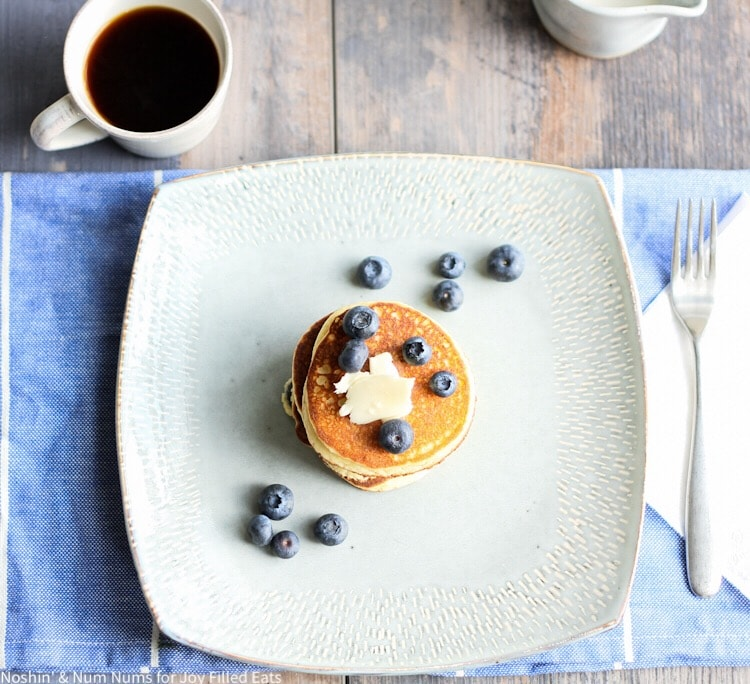 a blue plate with low carb lemon ricotta blueberry pancakes