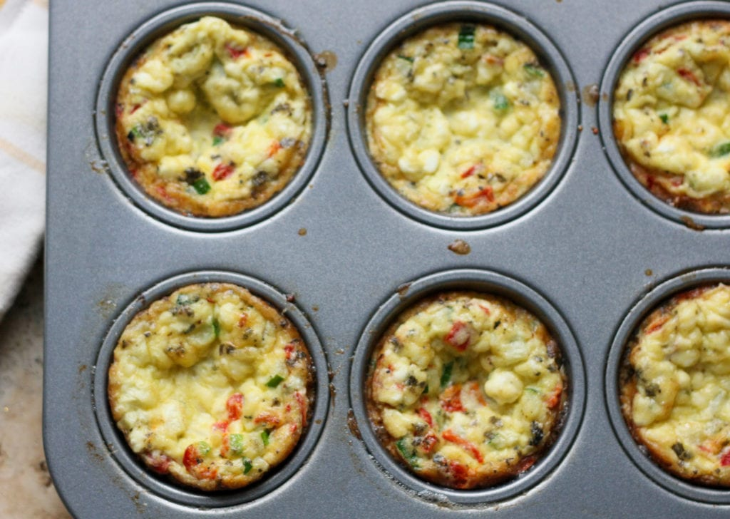 egg muffins just out of the muffin in a tin