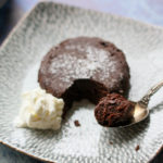 molten chocolate lava cake with cream on a blue plate