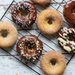 keto baked cake donuts on a baking rack