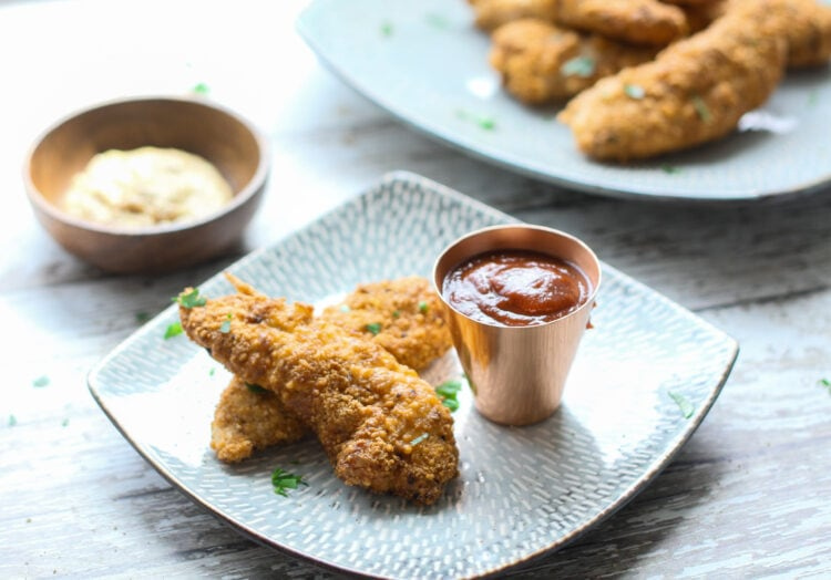 keto low carb chicken tenders on a plate with bbq dipping sauce