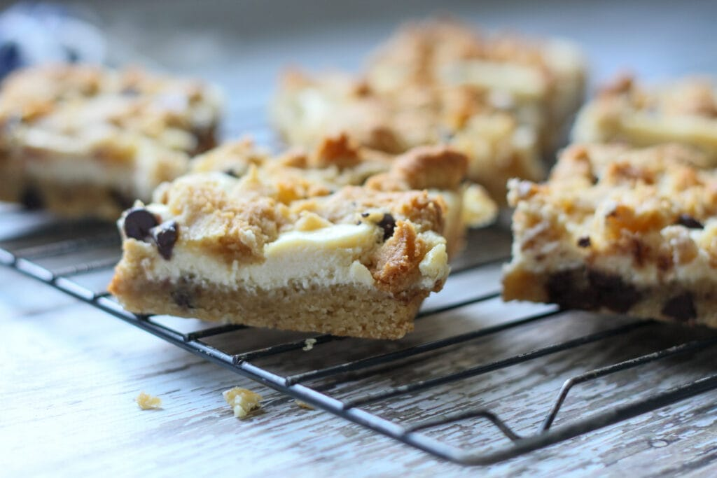 low carb sugar free cheesecake bars cooling on a baking rack