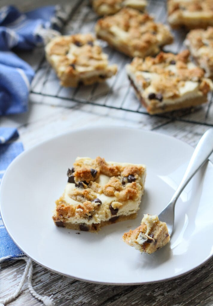slice of cookie dough cheesecake bar on a white plate