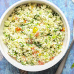 overhead picture of keto low carb cauliflower tabbouleh salad in a white bowl