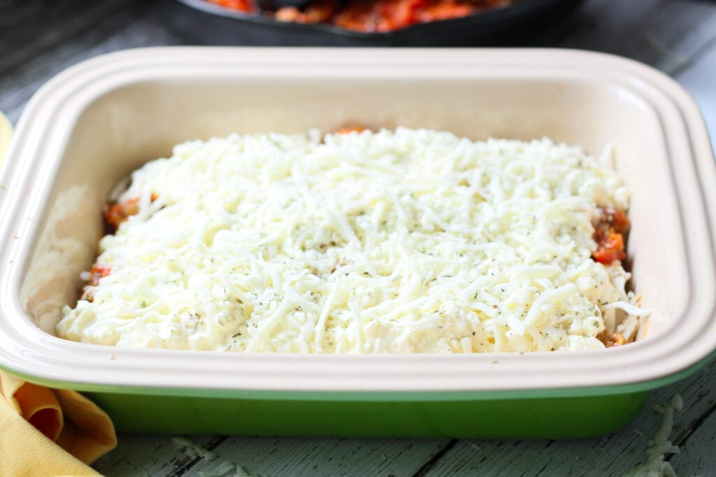 one layer of keto no noodle lasagna in a baking dish