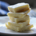 low carb keto lemon blondies stacked in a tower on a white plate