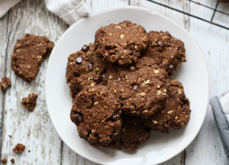 vegan oatmeal chocolate chip cookies on a white plate