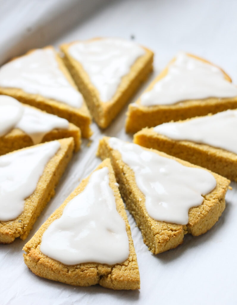 keto pumpkin spice scones with first layer of vanilla glaze