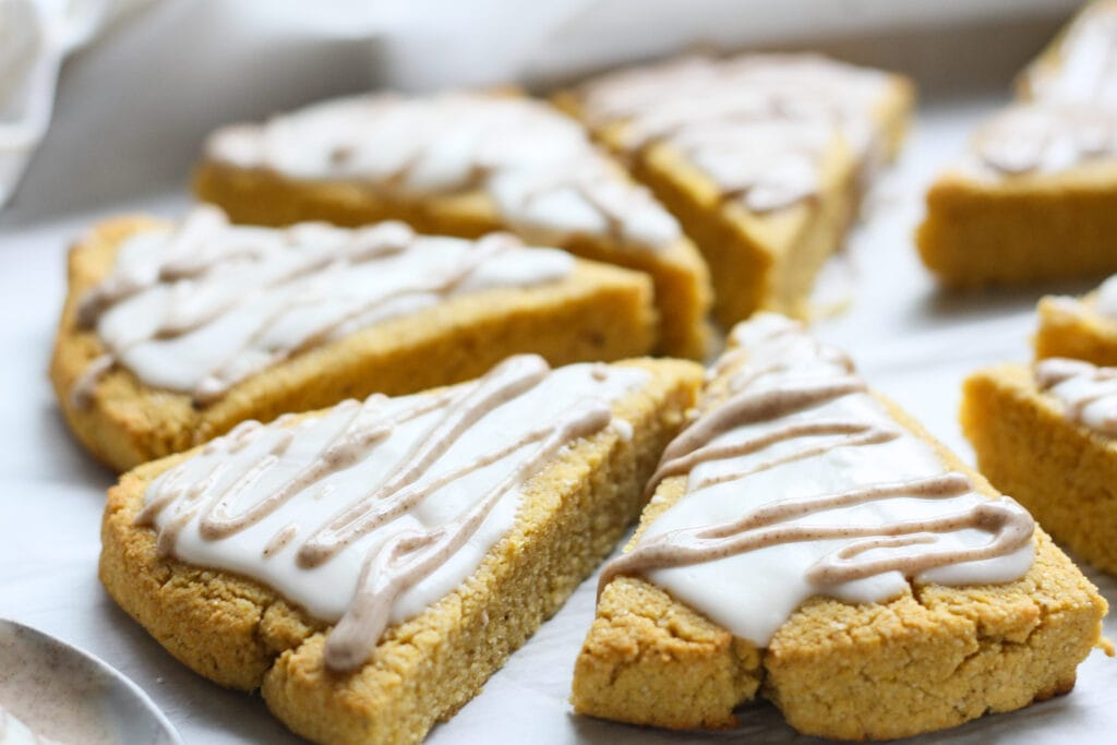 side view of cinnamon spice glazed keto pumpkin scones