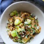 farro risotto with brussels sprouts in a white bowl