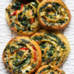 keto spinach pinwheels on a white plate