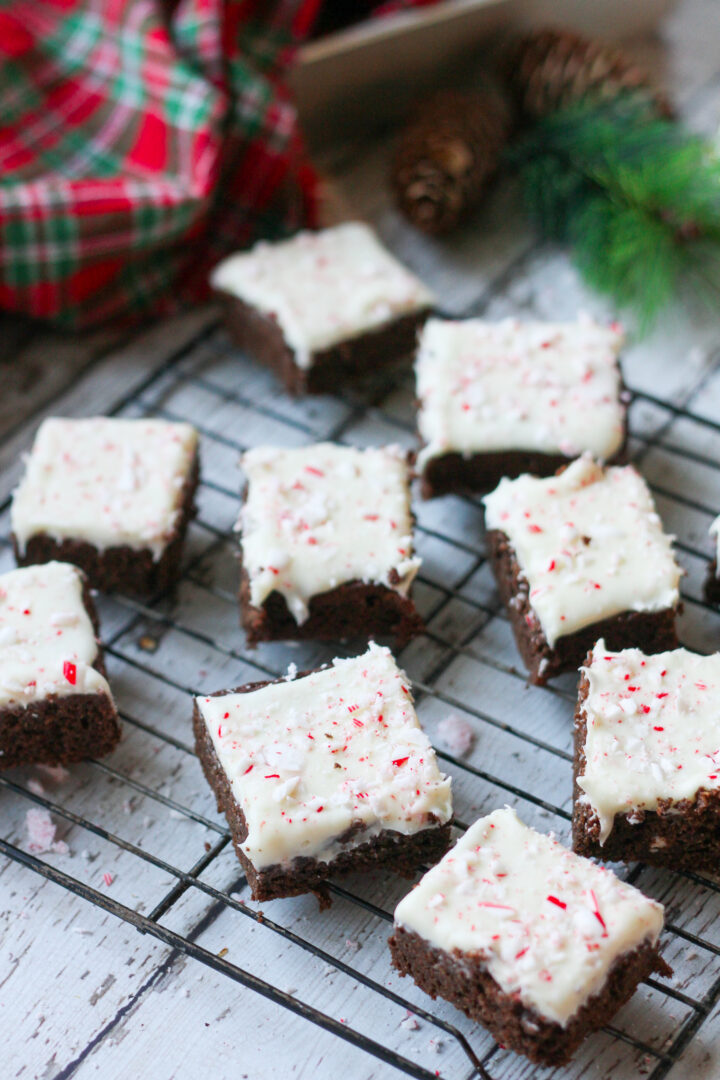 sliced keto peppermint mocha brownies frosted with white chocolate ganache on a cooling rack